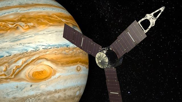 ilustração de sonda passando próxima ao planeta júpiter